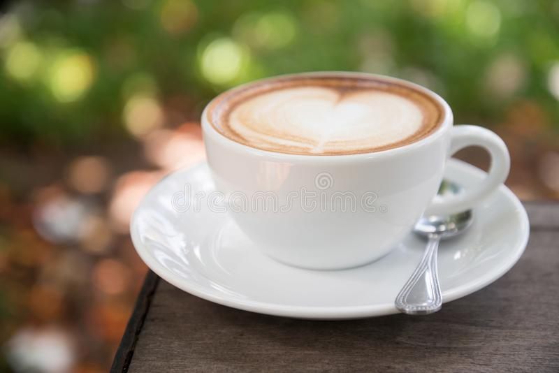 Latte on White Ceramic Cup With Saucer in Macro Photography stock image