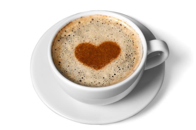 Lattekaffe med hjärtasymbol som isoleras på vit royaltyfria foton