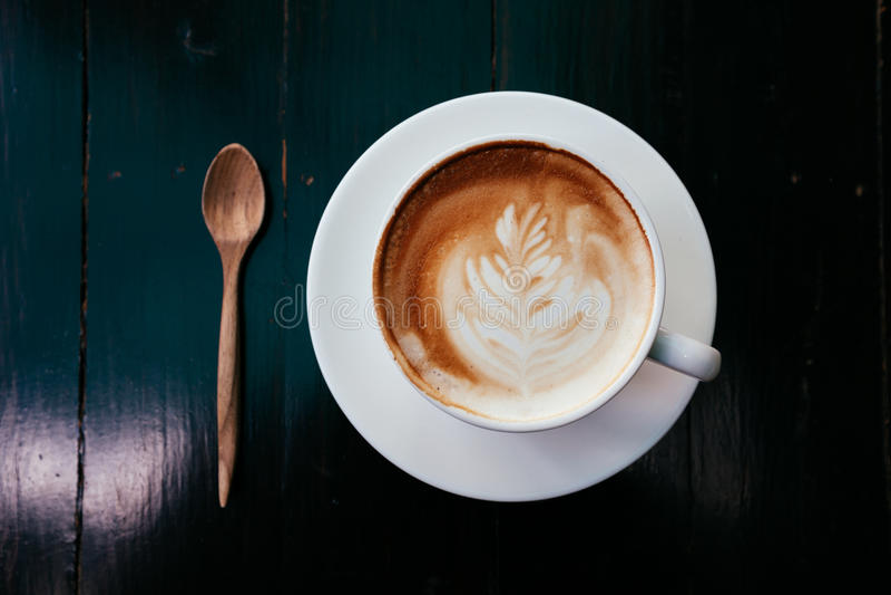 Lattekunst-Kaffeetasse - Weinleseeffekt-Artbilder lizenzfreies stockfoto