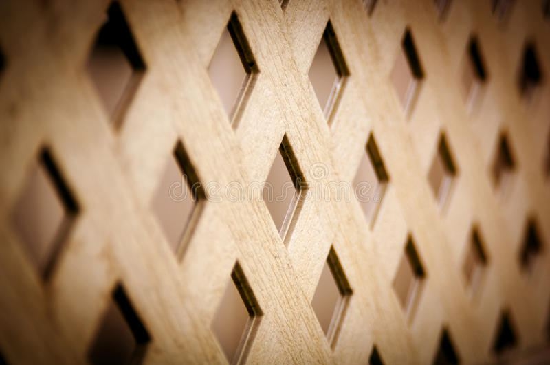 Lattice Pattern. Classic lattice pattern on a fence in vintage style royalty free stock image