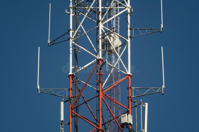 Lattice telecommunication tower. With microwave and GSM antennas royalty free stock photo
