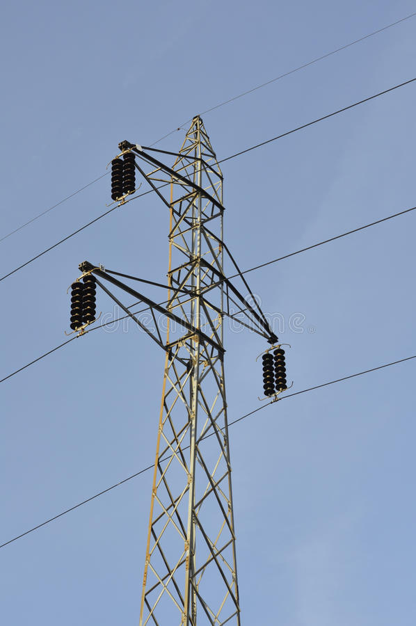 Lattice-type steel tower as a part of high-voltage lin. E. Overhead power line details. The structure used to transmit electrical energy in electric power stock photos