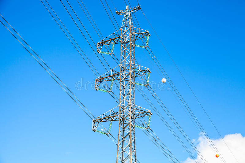 Lattice-type steel tower. As a part of high-voltage line. Overhead power line details. The structure used to transmit electrical energy in electric power stock photography