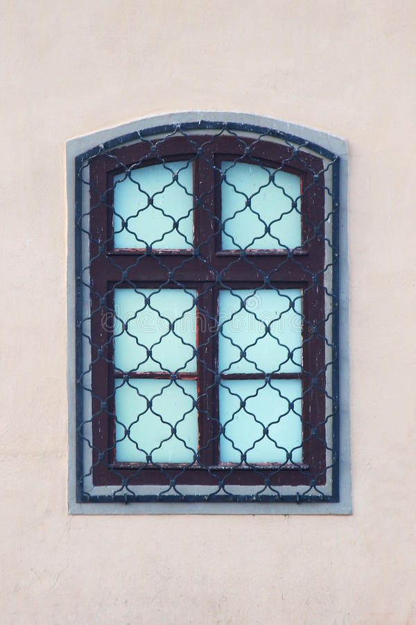 Latticed window on building wall, isolated stock photo