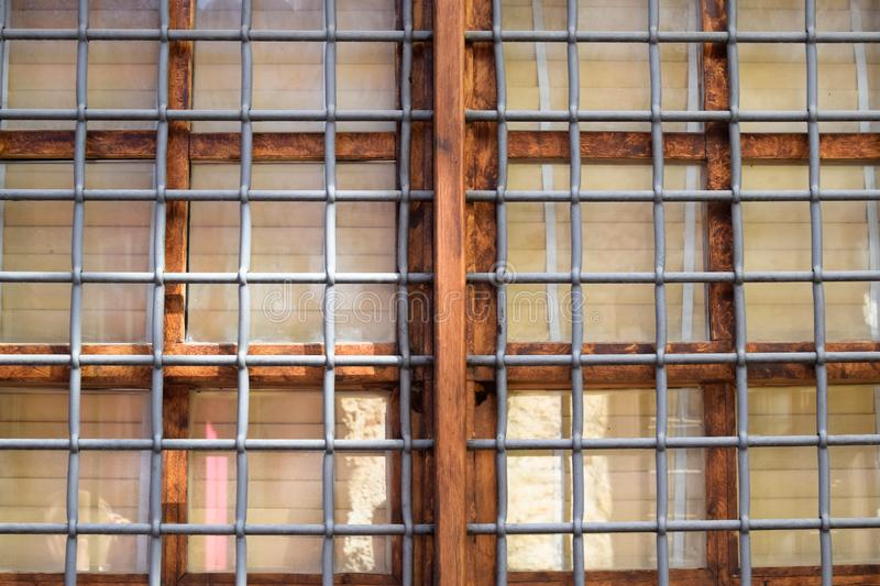 Metal bars in front of the window frame royalty free stock image