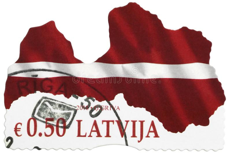 LATVIA - 2018: A contemporary postage stamp printed in LATVIA, stylized red white flag of the Republic of Latvia, European Union royalty free stock photo