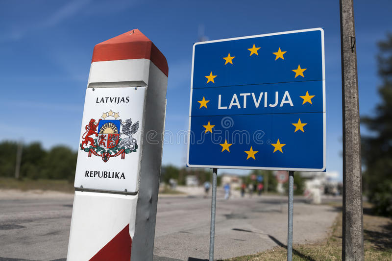 Latvia country border sign. General Schengen country border sign of Latvia located on the border between Latvia and Lithuania stock image