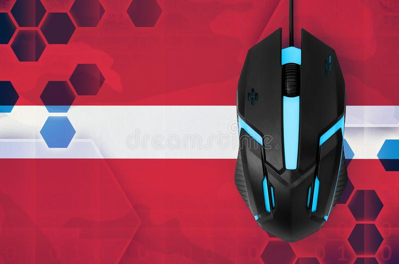 Latvia flag and computer mouse. Concept of country representing e-sports team. Latvia flag and modern backlit computer mouse. Concept of country representing e royalty free stock images