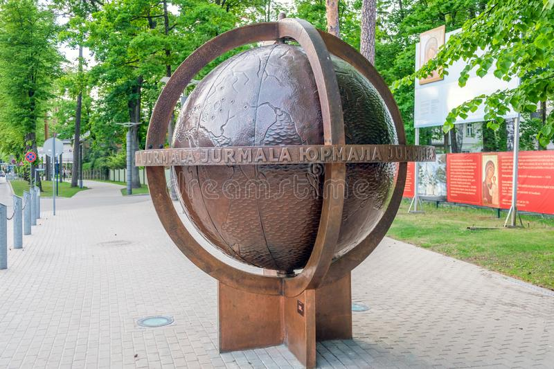 Latvia. Jurmala Yurmala, 09 June 2017: Symbolic globe on central Jomas street in Jurmala royalty free stock photo