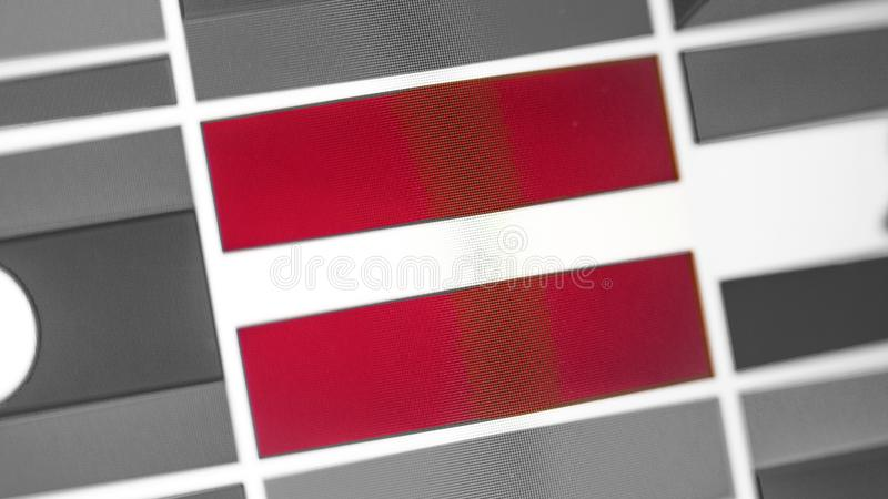 Latvia national flag of country. Latvia flag on the display, a digital moire effect. News of geography and geopolitics royalty free stock image