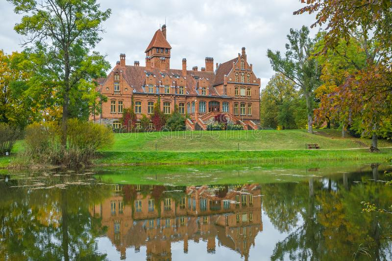 latvia old red castle with orange roof old building style 2015 its travel photo