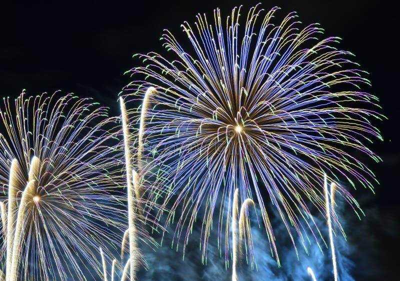 Latvia`s 100th anniversary - 18th November 2018. Fireworks on dark background in Riga, the capital city of Latvia stock image