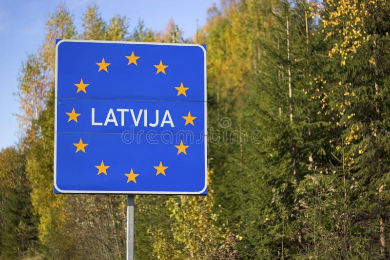 Latvia sign. Latvia border sign in autumn royalty free stock image