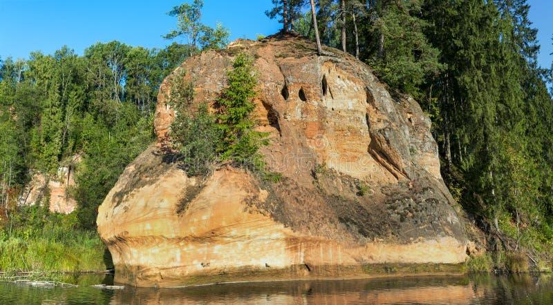 Sand rocks zvartes red rocks on Amata river, Latvia stock photo