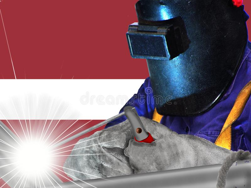 LATVIA WELDER WITH BACKGROUND OF HIS. FLAG WAVES, WORKER THAT GENERATES WELL-BEING AND RICHES TO HIS COUNTRY AND TO THE WHOLE WORLD royalty free stock image