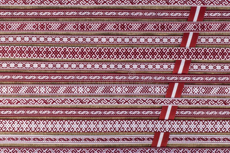 Latvian national style background with ornamented ribbons. Striped background, top view royalty free stock images