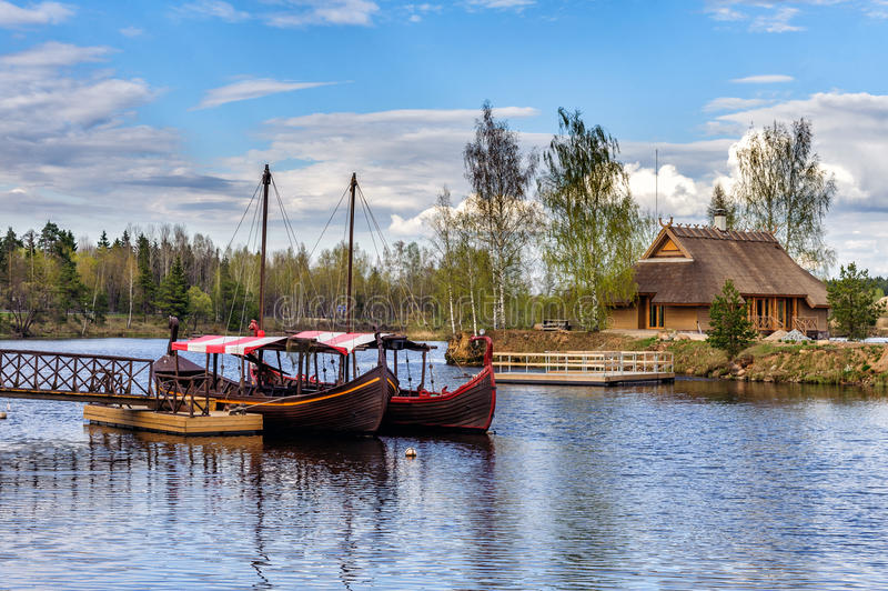 Latvian wooden sailing boats near small pier at Liepkalni town, Latvia royalty free stock photos