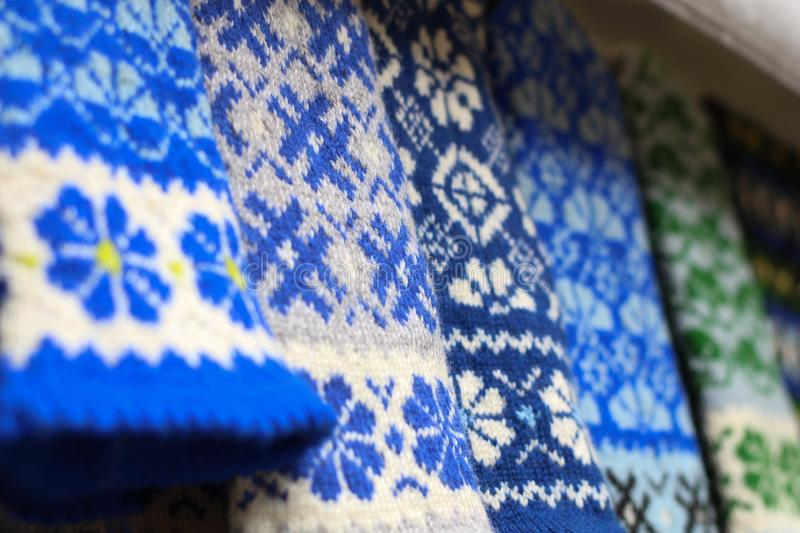 Blue and white Hand-knitted Latvian Wool Mittens. Latvian Rustic mittens, Ethnic style Knitted wool gloves Winter. Christmas Marke royalty free stock images