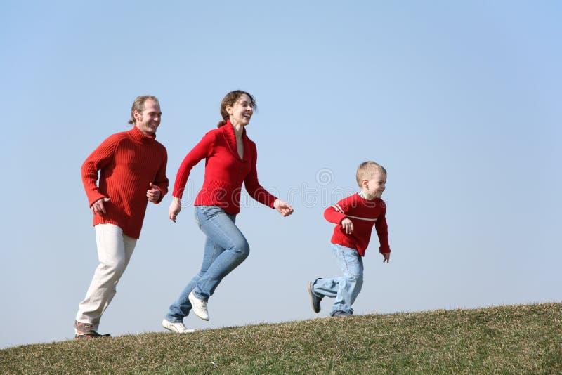 Laufende Familie stockbild