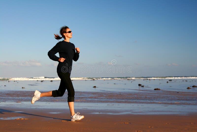 Laufende Frau lizenzfreie stockbilder