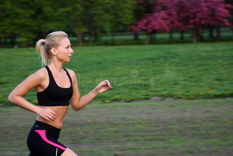 Laufende Frau stockbild