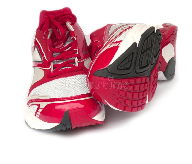 Laufende Schuhe des Sports getrennt auf weißem Hintergrund stockfoto