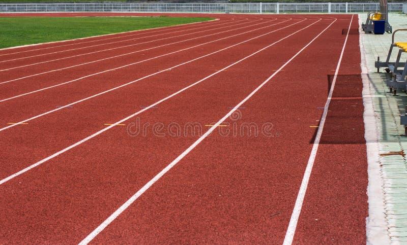 Laufende Spur im Stadion lizenzfreies stockbild