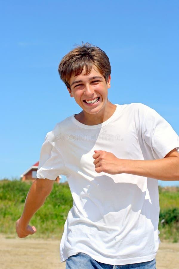 Laufender Jugendlicher lizenzfreie stockfotografie