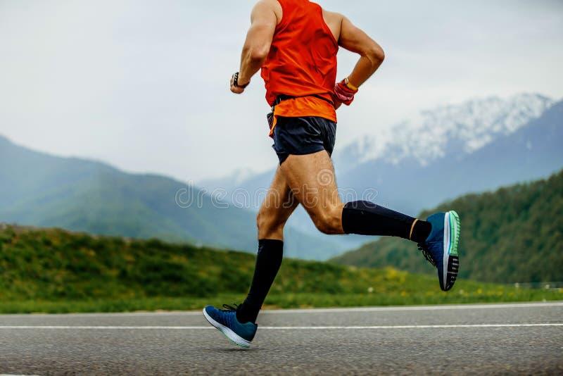 Laufender Mannathlet stockfoto