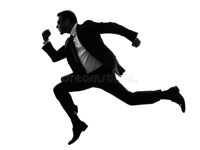 Laufendes Schattenbild des Manngeheimagenten stockbilder