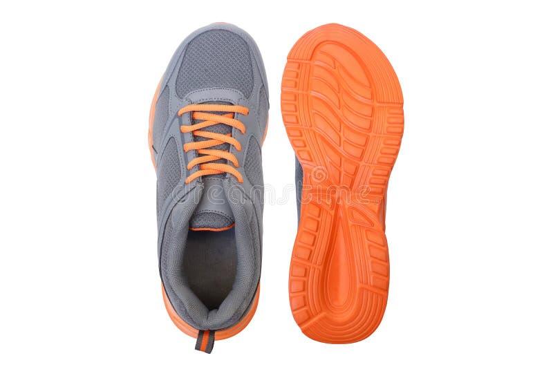Laufschuhe mit den grauen und orange Farben lizenzfreies stockfoto