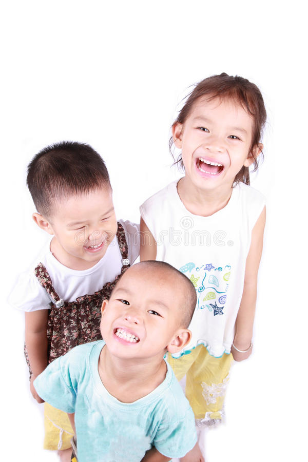 Laugh. Three chinese children are laughing with white background royalty free stock photography