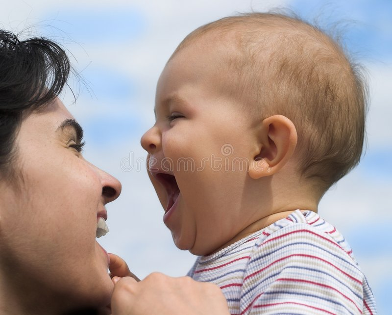 Laugh. Mother and baby are laughing together royalty free stock photo