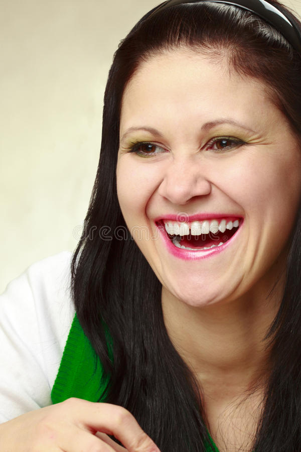 Laugh. Closeup laughing woman portrait over yellow royalty free stock image
