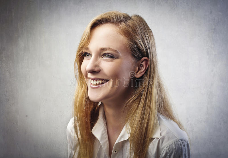 Laugh. Portrait of a beautiful young woman laughing stock photo