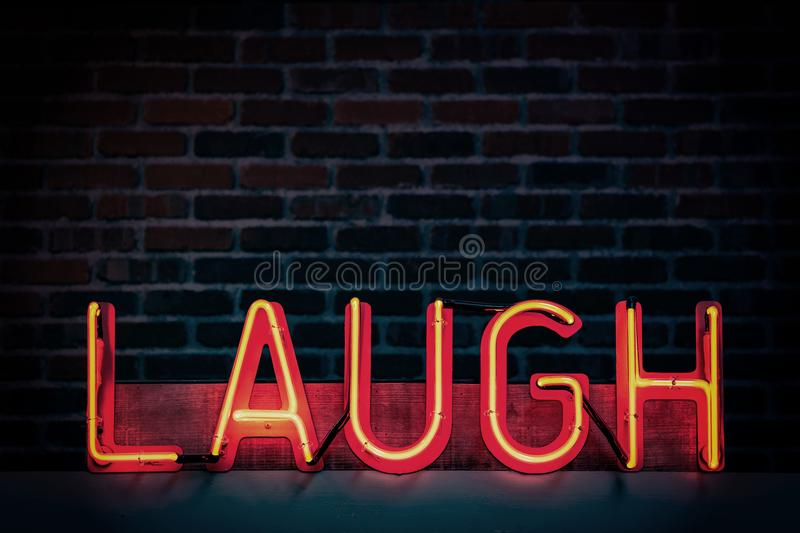 Laugh Neon-light Signage Turned on stock image