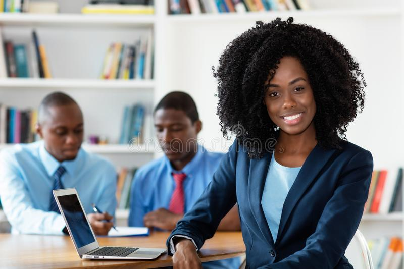 Laughing african african businesswoman with business team royalty free stock photos