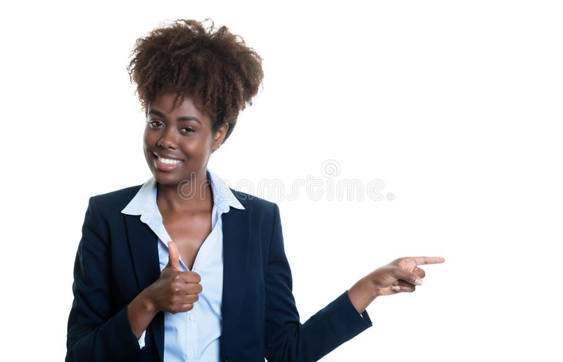 Laughing african american business woman pointing sideways and s. Howing thumb on an isolated white background for cut out royalty free stock image