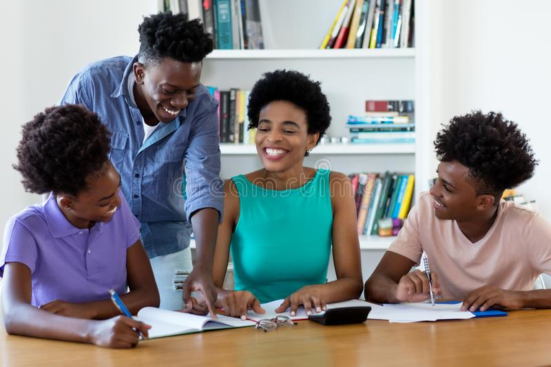 Laughing african american female tutor teaching students royalty free stock photo