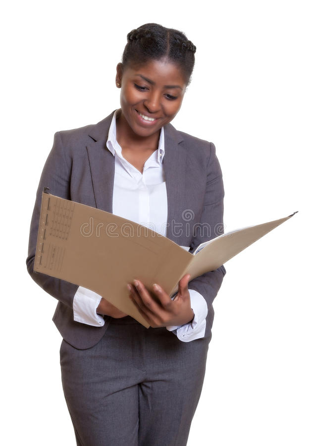 Laughing african business woman reading file. On an isolated white background for cut out stock photos