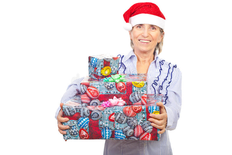 Download Laughing Aged Woman Holding Christmas Presents Stock Photo - Image: 16713304