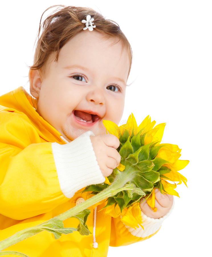 Free Laughing Baby With Sunflower Stock Photography - 10646942