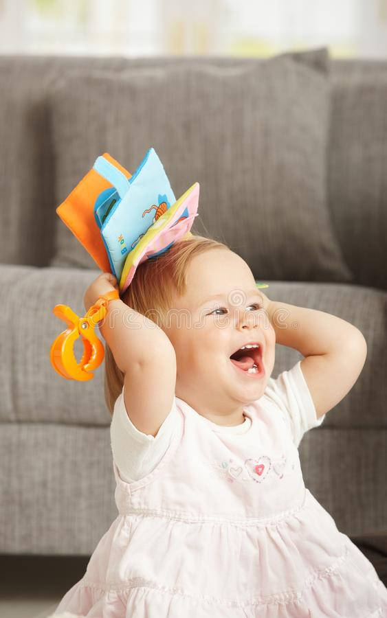 Download Laughing babygirl with toy stock image. Image of couch - 13303363