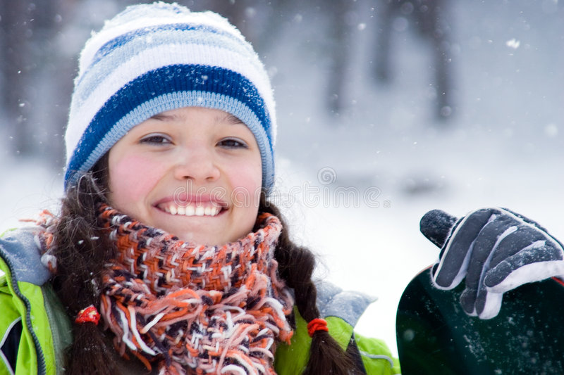 Laughing beautiful girl snowboarder stock photo