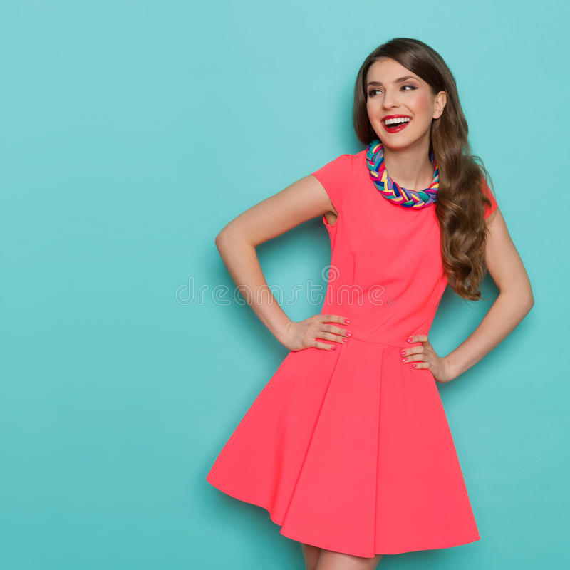 Laughing Beautiful Woman In Pink Mini Dress Looking Away stock images