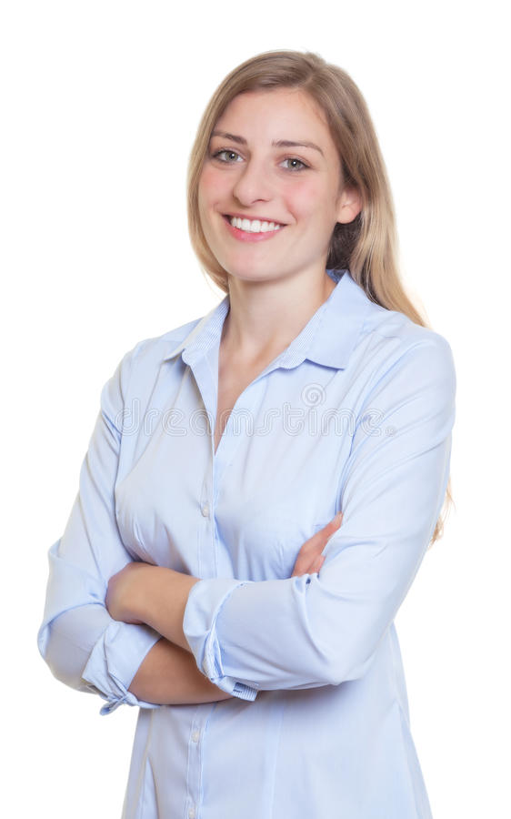 Laughing blonde german woman in blue blouse with crossed arms. On an isolated white background for cut out stock images