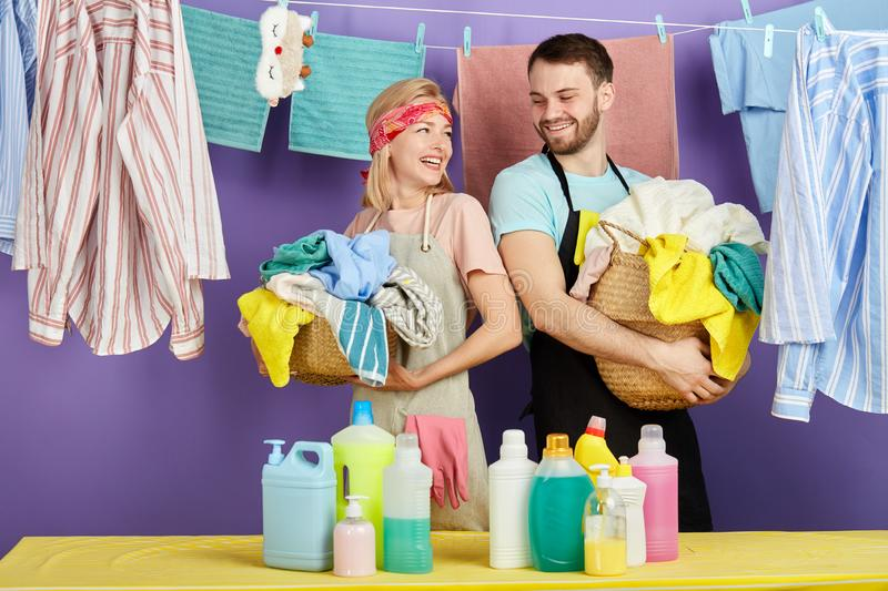 Laughing blonde woman and bearded man in stylish casual clothes having fun stock images