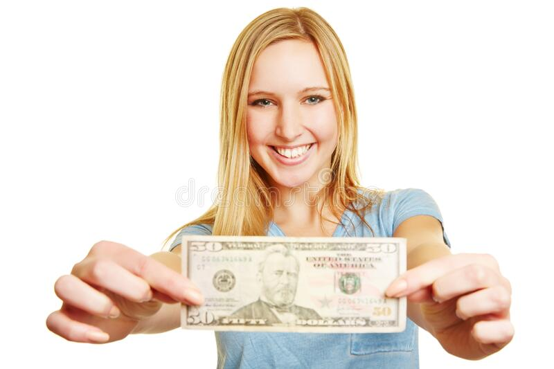 Blond woman holds 50 dollar bill. Laughing blonde woman holds a 50 dollar bill at the camera stock images