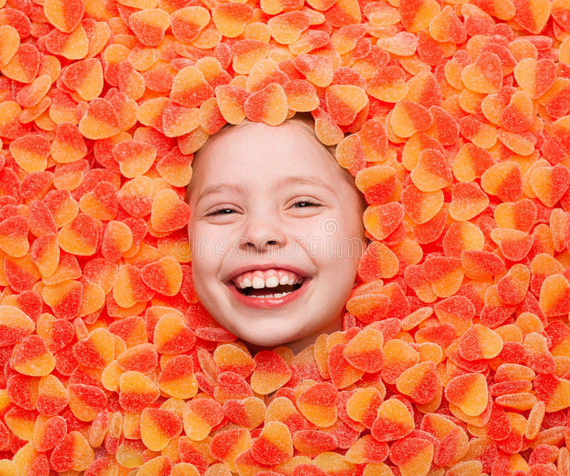 Laughing boy covered with fruit jelly. Boy`s face lying in fruit jelly and laughing at camera royalty free stock photo