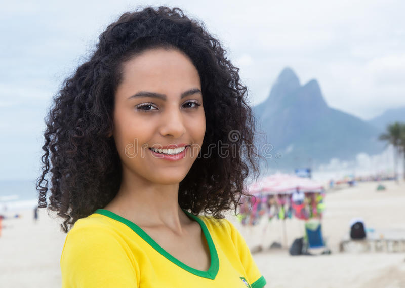 Laughing brazilian sports fan with curly hair at Rio de Janeiro royalty free stock photos